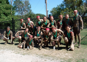 The founding members covered in mud on the day I met Erin